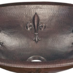 close-up view of franklin drop-in copper kitchen sink and embossed fleur design