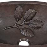 close up of leaf design embossing of franklin undermount copper bathroom sink