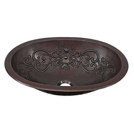 45 degree view of pauling undermount copper kitchen sink with scroll design embossment