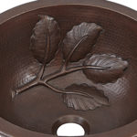 close up view of newton drop-in copper sink with tree branch embossing