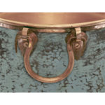 close-up of copper handles and verde finish of nobel vessel copper bathroom sink