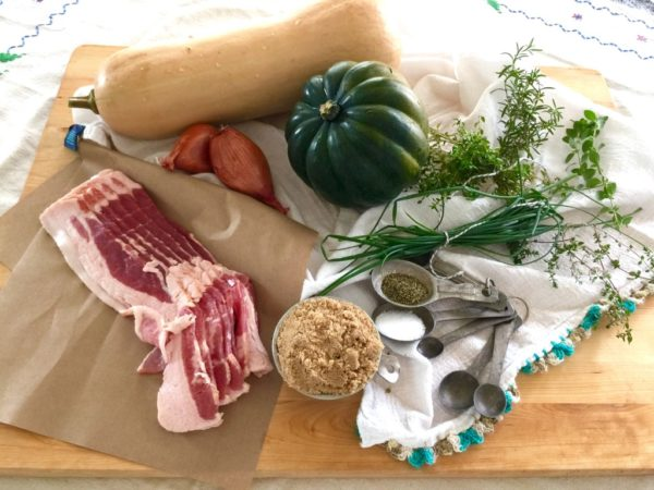 ingredients for oven roasted autumn squash with candied bacon and fresh herbs