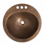 top view of hand hammered bell drop-in copper sink