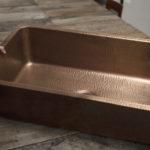 david undermount copper kitchen sink sitting on a rough wooden table