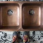 top view of rivera undermount double bowl copper kitchen sink and boots