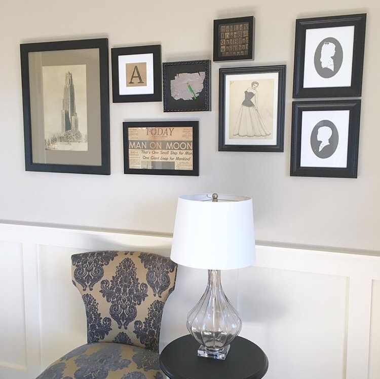 sitting space with white walls and picture frames