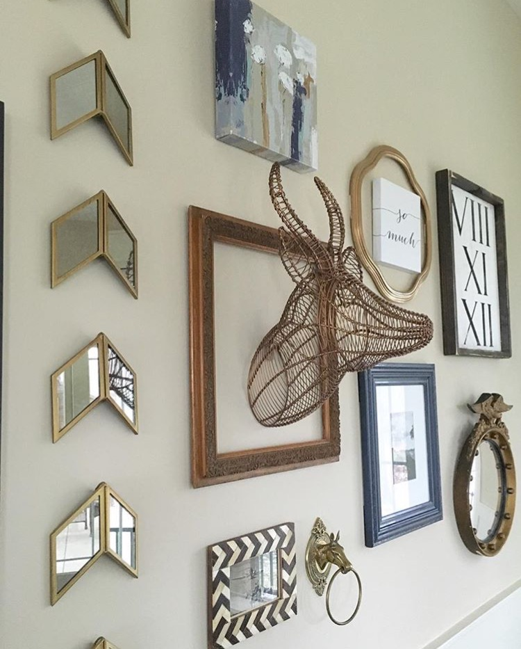 wall design with mirrors picture frames and other decorations