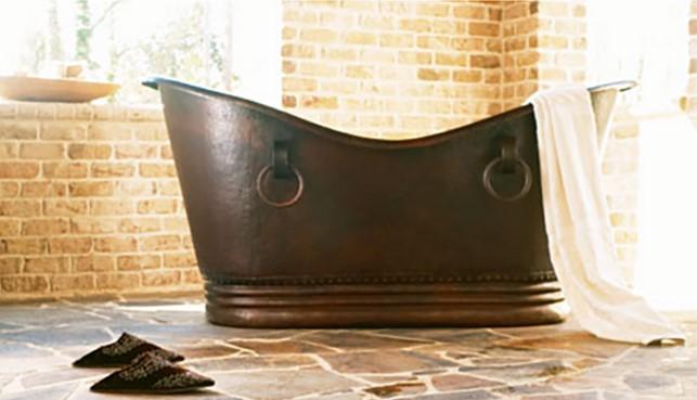 copper bathtub from sinkology installed in earth-tone bathroom