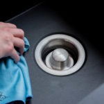 stainless steel disposal drain with logo in place
