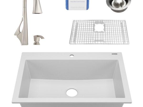 white granite single bowl kitchen sink, faucet, grid, scrubber, and disposal drain