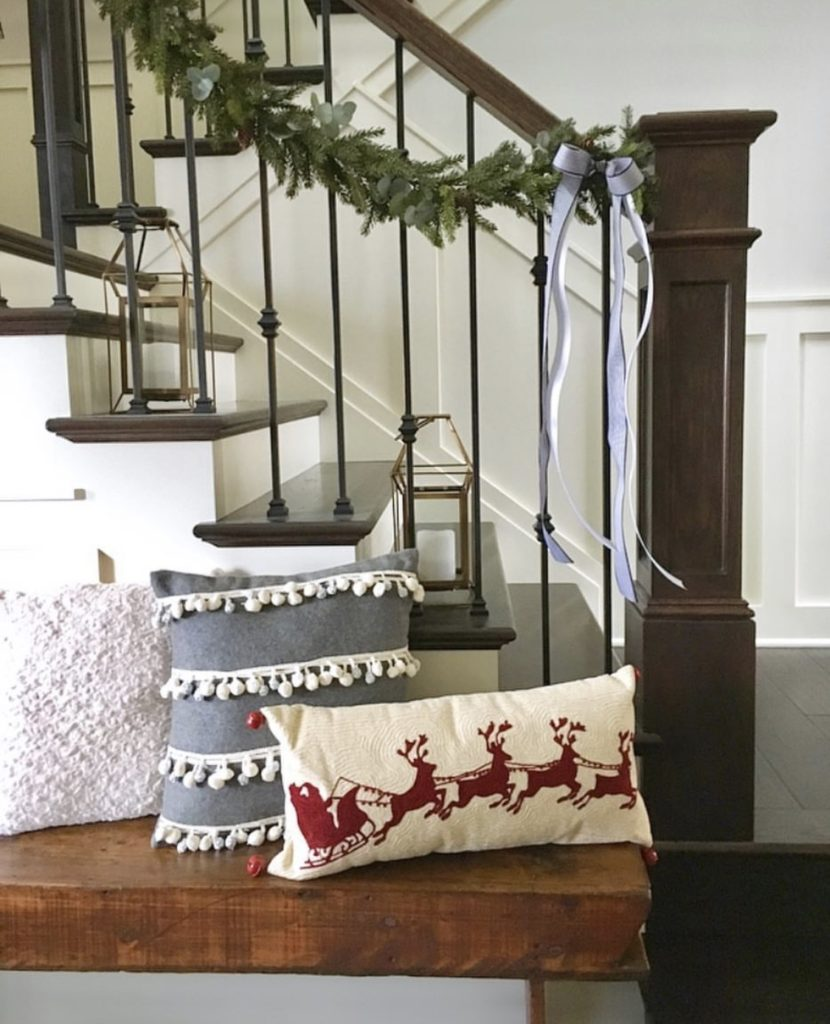 Staircase with garland and pillows