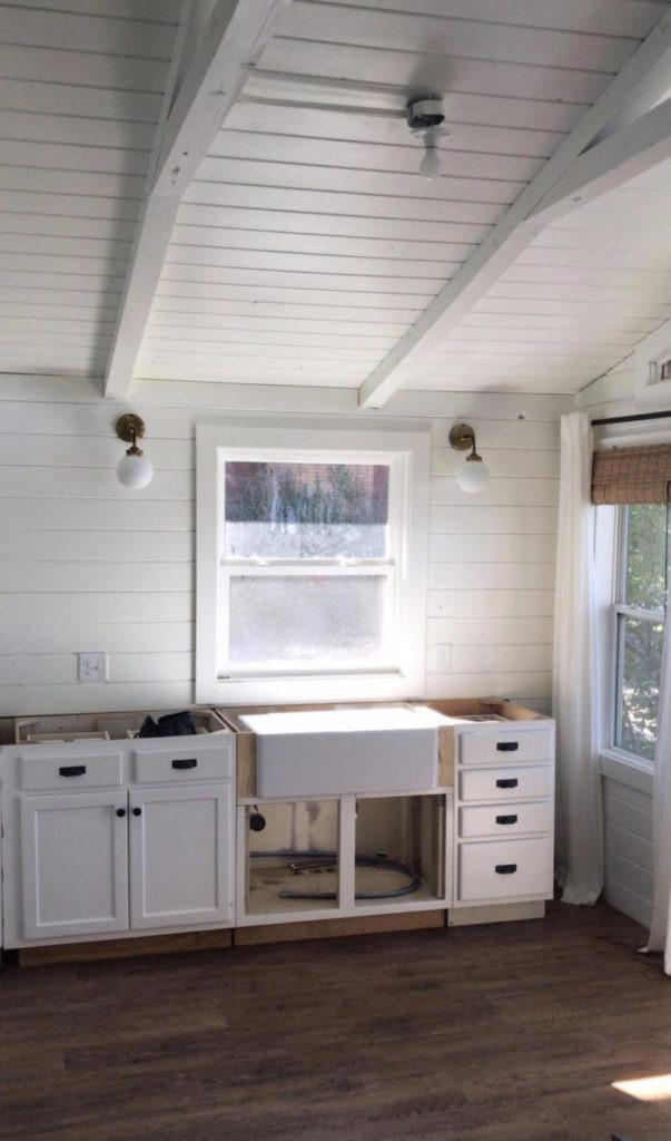 sink being installed to cabin kitchen