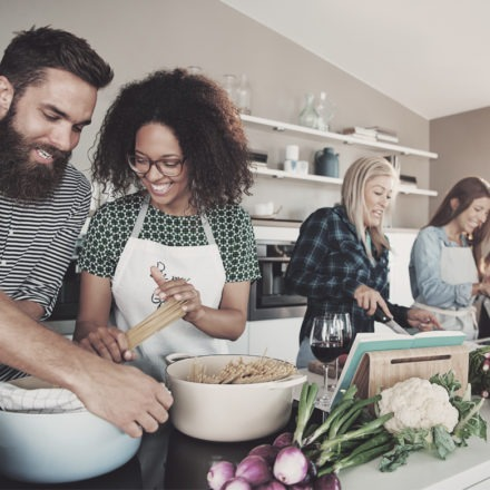 VIBE Collection friends cooking and enjoying each others company around kitchen island