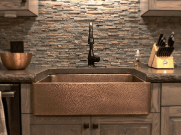 copper sink in dark kitchen