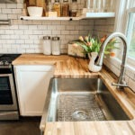Crafted Stainless Steel Kitchen Sink with flowers in a vase on the countertop