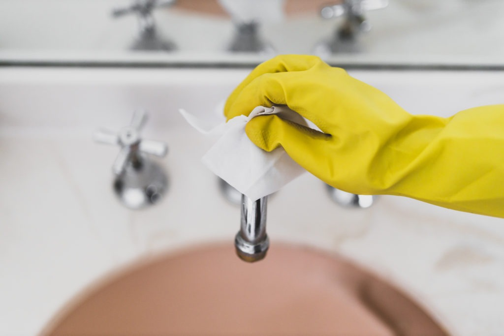 disinfecting sink with glove