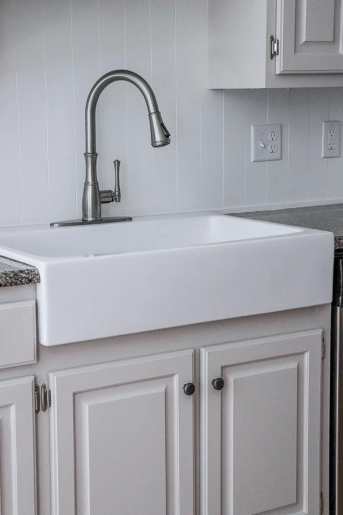 white farmhouse sink installed