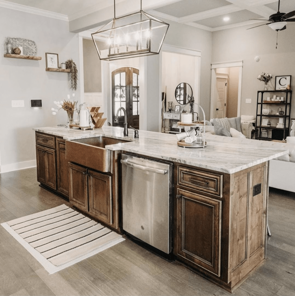 Kitchen with copper sink and marble countertops