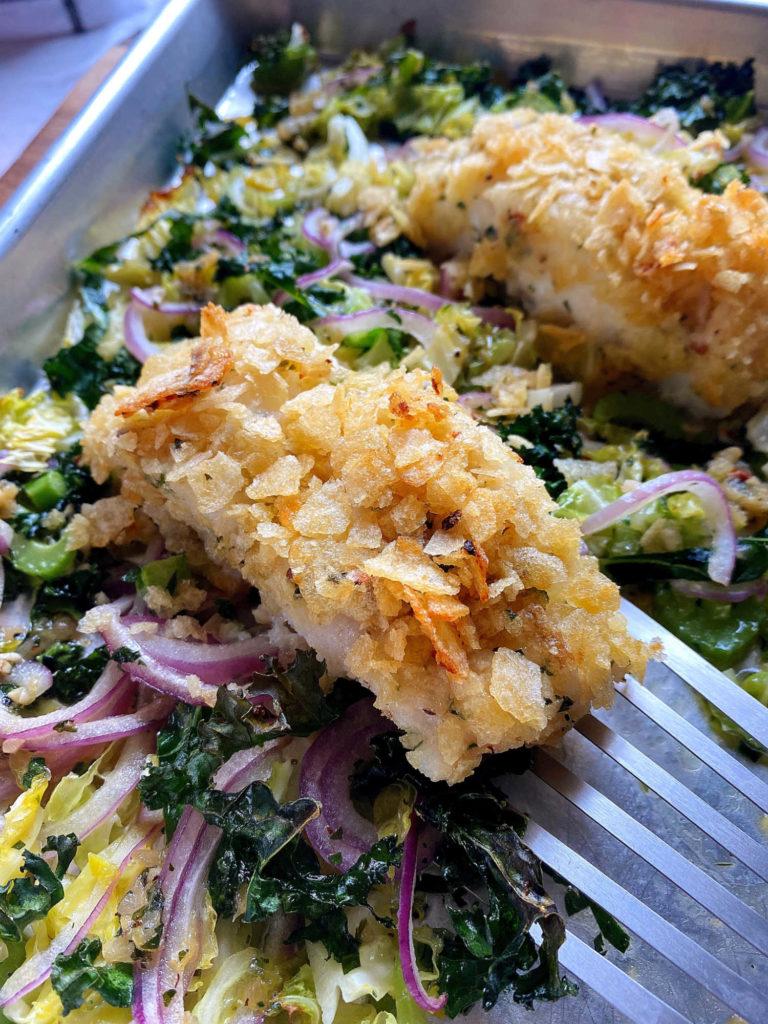 serving potato chip cod and veggies